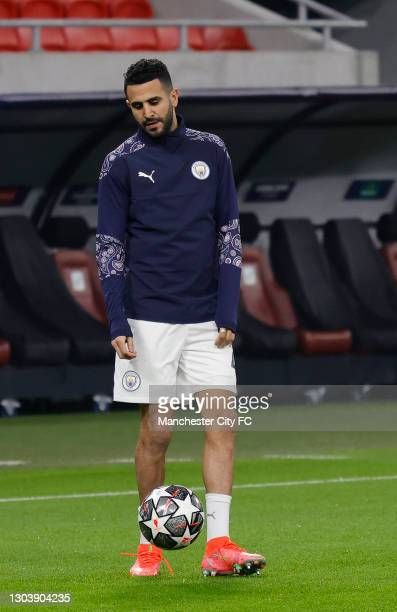 Riyad Mahrez of Manchester City warms up prior to the UEFA Champions League Round of 16 match between Borussia Mönchengladbach and Manchester City at...