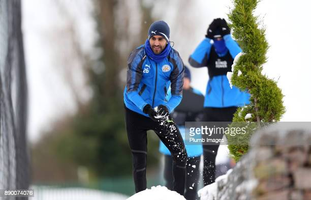 Riyad Mahrez plays in the snow during the Leicester City training session at Belvoir Drive Training Complex on December 11 2017 in Leicester United...