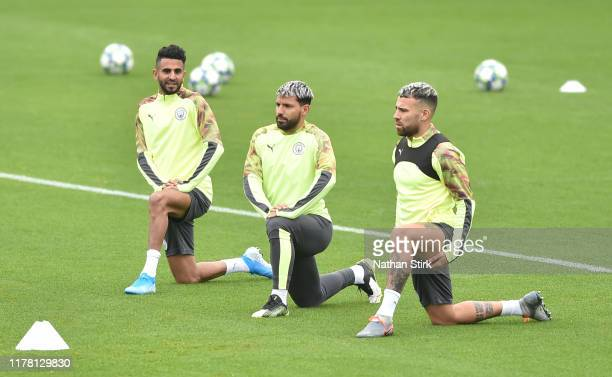 Riyad Mahrez Sergio Aguero and Nicols Otamendi of Manchester City takes part during a training session at Manchester City Football Academy at The...