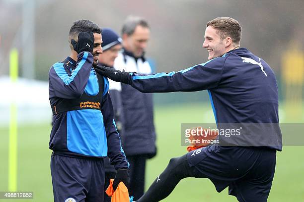 Riyad Mahrez shares a joke with Andy King during the Leicester City training session at Belvoir Drive Training Complex on November 26th 2015 in...