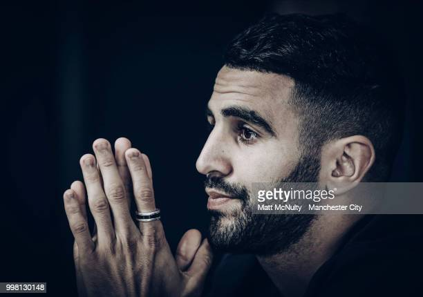 Riyad Mahrez speaks during the press conference after being unveiled at Manchester City Football Academy on July 12 2018 in Manchester England