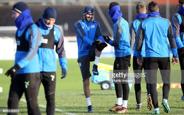 Riyad Mahrez talks to Demarai Gray during the Leicester City training session at Belvoir Drive Training Complex on December 11 2017 in Leicester...