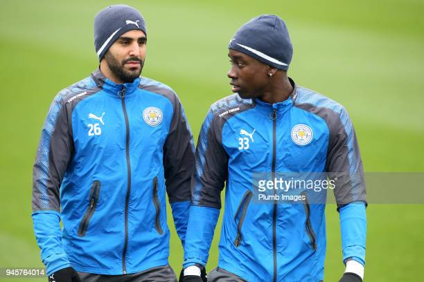 Riyad Mahrez with Fousenni Diabate during the Leicester City training session at Belvoir Drive Training Complex on April 13 2018 in Leicester United...