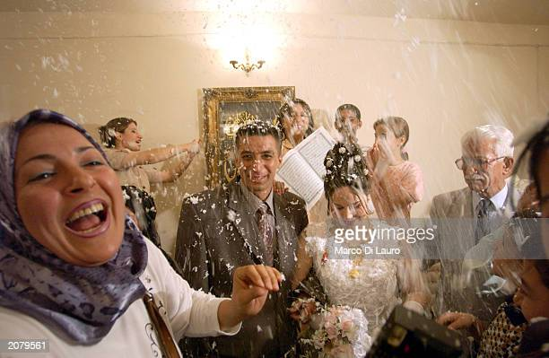 Riyad Saad and Mayda Hashim celebrate their wedding in their house June 6 2003 in Baghdad Iraq Riyad and Mayda are first grade cousins who are not...