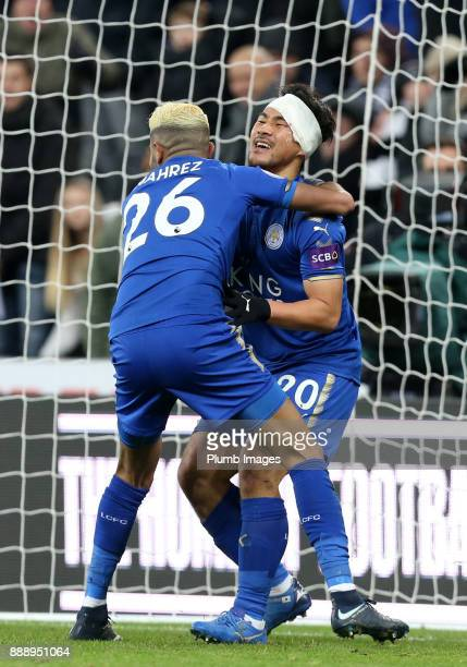 Riyadh Mahrez and Shinji Okazaki of Leicester celebrate after an own goal by Ayoze Perez of Newcastle United to make it 31 during the Premier League...