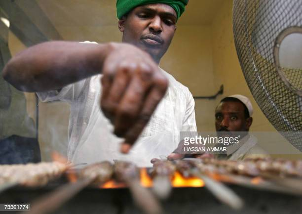 A Saudi man grills meat at his shop in the Janadriyah Festival of Heritage and Culture on the outskirts of the Saudi capital of Riyadh 18 February...