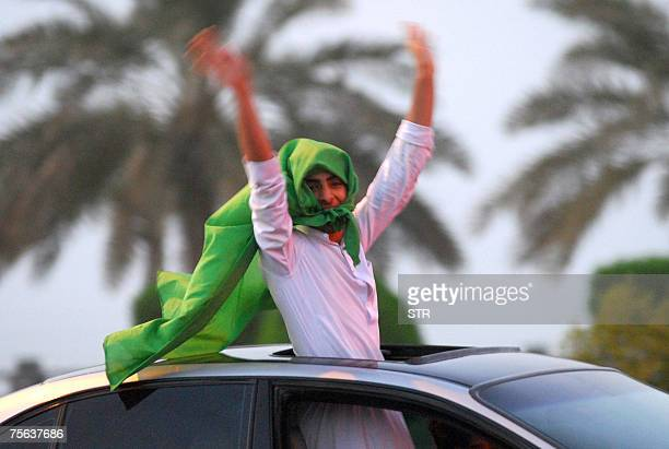 A Saudi youth celebrates in the capital Riyadh his country's football team victory against Japan for the semifinal of the Asian Cup 2007 25 July 2007...