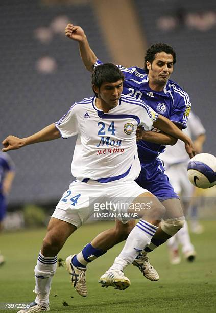 CORRECTING TYPO IN TEAM'S NAME Yasser alQahtani of Saudi alHilal club vies for the ball with Uzbek Pakhtakor club player Anzur Ismailov during their...