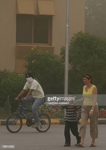 Foreigners protect themselves from dust at a compound during a massive sandstorm in Riyadh 18 April 2007The spring season sandstorms called...