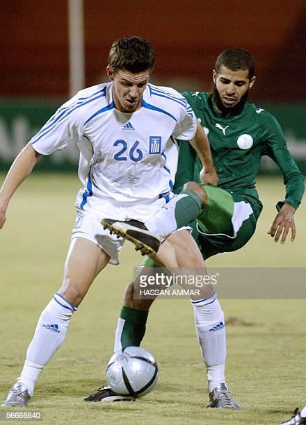 GreeK player Mantzioz Evangelos vies with Saudi player Abdulaziz Al Khathran during an international friendly match in Riyadh 25 January 2006 AFP...