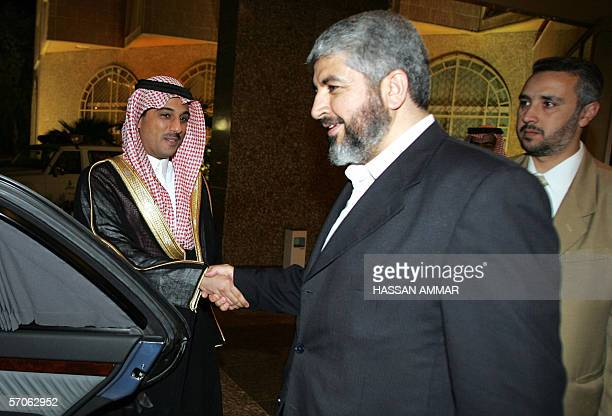 Hamas leader Khaled Meshaal is greeted by a Saudi man at a conference palace in Riyadh, 12 March 2006. A visiting Hamas delegation said yesterday...