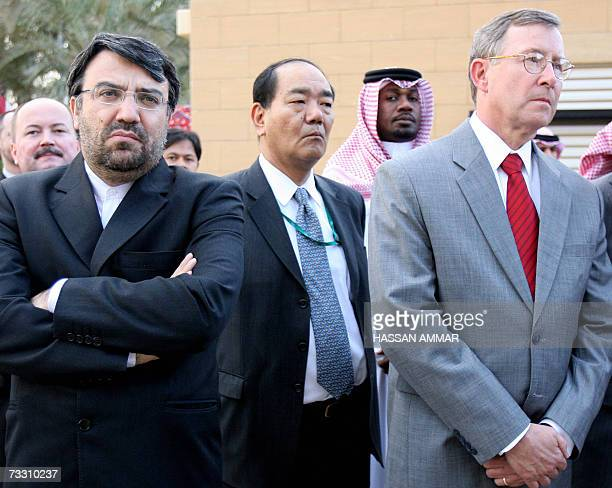 Iran's Ambassador in Saudi Arabia Seyed Mohammad Hosseini and US Ambassador in Saudi Arabia James Oberwetter attend the reopening of the Iraqi...