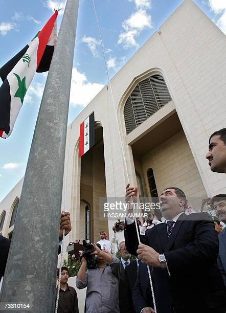 Iraqi Foreign Minister Hoshyar Zebari raises his national flag at the Iraqi embassy in Riyadh 13 February 2007 Zebari formally reopened Iraq's...