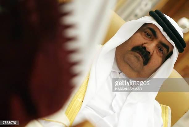 Qatar's Emir Sheikh Hamad bin Khalifa al-Thani attends the opening session of a two-day summit in the Saudi capital Riyadh, 28 March 2007. Arab...