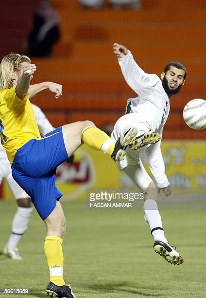 Saudi player Abdulaziz Khathran vies with Sweden player Fredrik Bergiund during an international friendly football match in Riyadh 18 January 2006...
