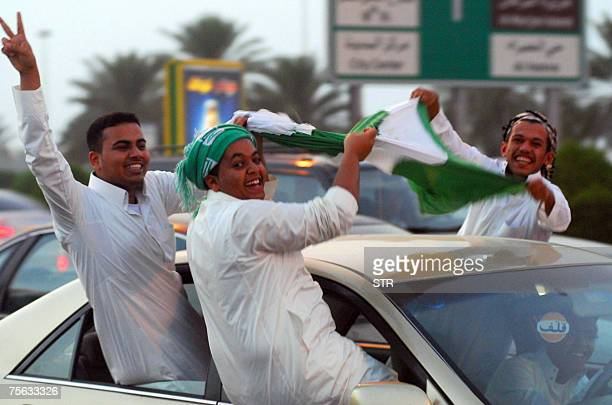 Saudi youths celebrate in the capital Riyadh their country's football team victory against Japan for the semifinal of the Asian Cup 2007 25 July 2007...