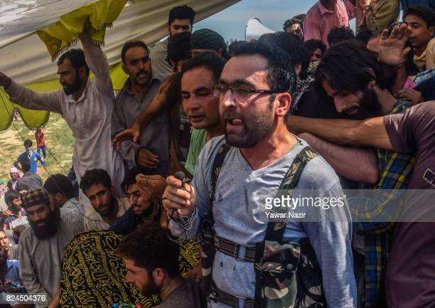 Riyaz Naikoo a top commander of Kashmir's largest rebel group Hizbul Mujahideen addresses Kashmiri Muslims during the funeral of Shariq Ahmad a local...