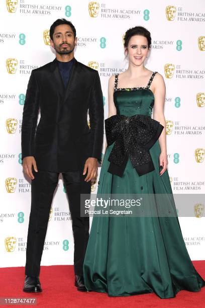 Riz Ahmed and Rachel Brosnahan pose in the press room during the EE British Academy Film Awards at Royal Albert Hall on February 10 2019 in London...