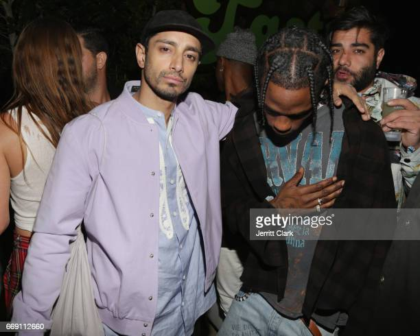 Riz Ahmed and Travis Scott attend the Moschino Candy Crush Desert Party hosted by Jeremy Scott on April 15 2017 in Coachella California