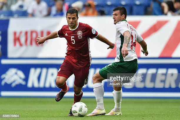 Riza Durmisi of Denmark and Ventsislav Vasilev of Bulgaria compete for the ball during the international friendly match between Denmark and Bulgaria...