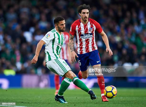 Riza Durmisi of Real Betis Balompie being followed by Sime Vrsaljko of Club Atletico de Madrid during the La Liga match between Real Betis and...