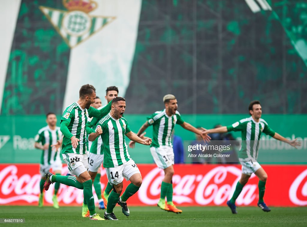Riza Durmisi of Real Betis Balompie celebrates after scoring the first goal for Real Betis Balompie with German Pezzella of Real Betis Balompie La Liga match between Real Betis Balompie and Sevilla FC at Benito Villamarin Stadium on February 25, 2017 in Seville, Spain.