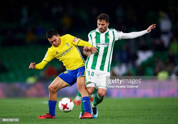 Riza Durmisi of Real Betis duels for the ball with Daniel Romera of Cadiz during the Copa del Rey Round of 32 Second Leg match between Real Betis...