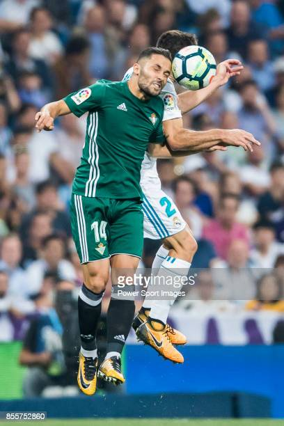 Riza Durmisi of Real Betis heads the ball during the La Liga 201718 match between Real Madrid and Real Betis at Estadio Santiago Bernabeu on 20...