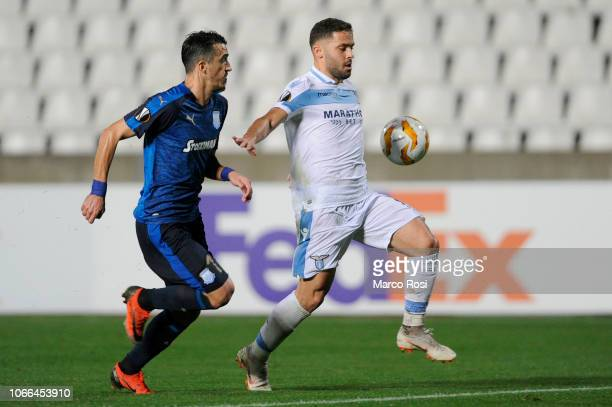 Riza Durmisi of SS lazio compete for the ball with Joao Pedr of Apollon Limassol during the UEFA Europa League Group H match between Apollon Limassol...