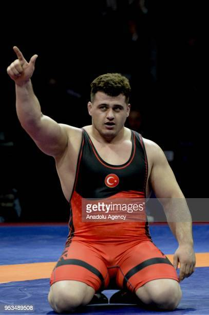 Riza Kayaalp of Turkey celebrates after winning against Vitalii Shchur of Russia in the Mens greco roman style 130kg category final match within the...
