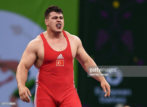 Riza Kayaalp of Turkey celebrates victory over Sabahi Shariati of Azerbaijan in the Men's Wrestling 130kg Greco Roman final during day two of the...