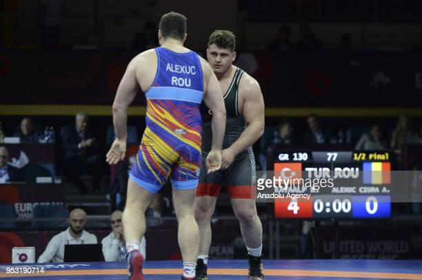 Riza Kayaalp of Turkey in action against Alin Alexuc Ciurariu of Romania in the Mens greco roman style 130kg category during the 2018 European...