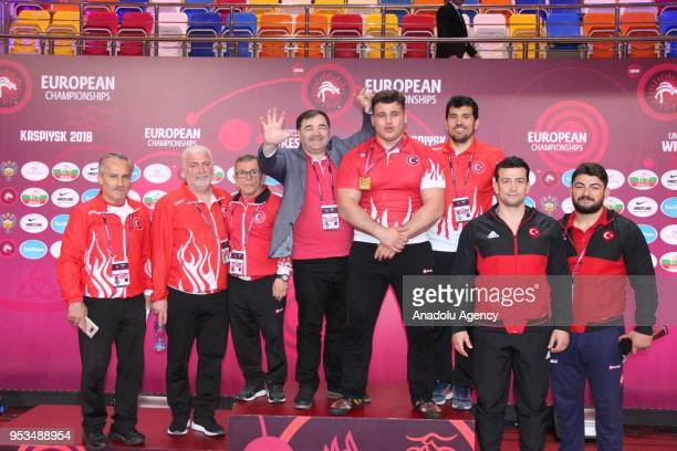 Riza Kayaalp of Turkey poses for a photo after winning the gold medal following the Mens greco roman style 130kg category final match against Vitalii...