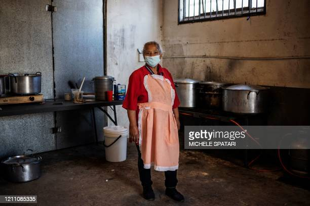 Rize Jacobs school teacher, poses for a picture in an improvised kitchen in the Malvern suburb in Johannesburg, on April 20 where she volunteers as...