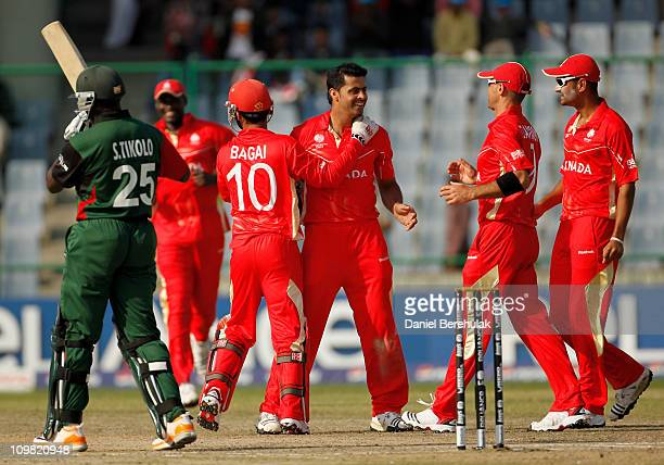 Rizwan Cheema of Canada celebrates with Ashish Bagai and teammates after taking the wicket of Steve Tikolo of Kenya during the ICC Cricket World Cup...