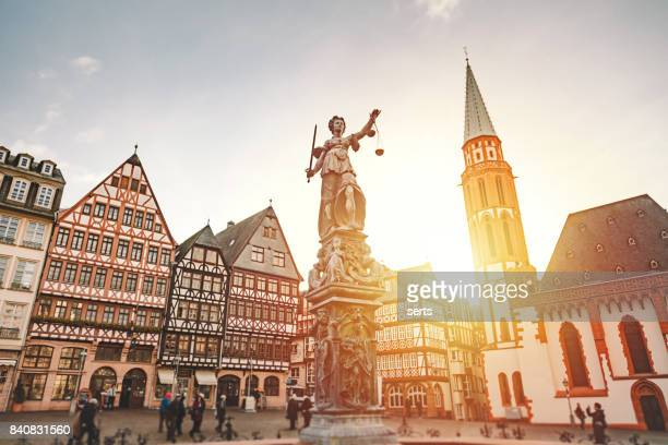 römerberg old town square in frankfurt, germany - lady justice stock pictures, royalty-free photos & images