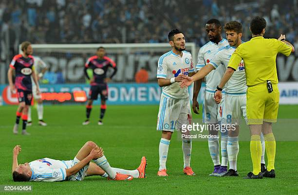 Rémy CabellaNicola Julio Nkoulou and Lucas Silva Borges from Marseille talking with refere during the French League 1 match between Olympique de...