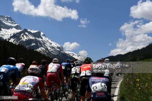 Rémy Rochas of France and Team Cofidis, Ben Tulett of United Kingdom and Team Alpecin-Fenix & The peloton passing through Col du Pillon mountain...