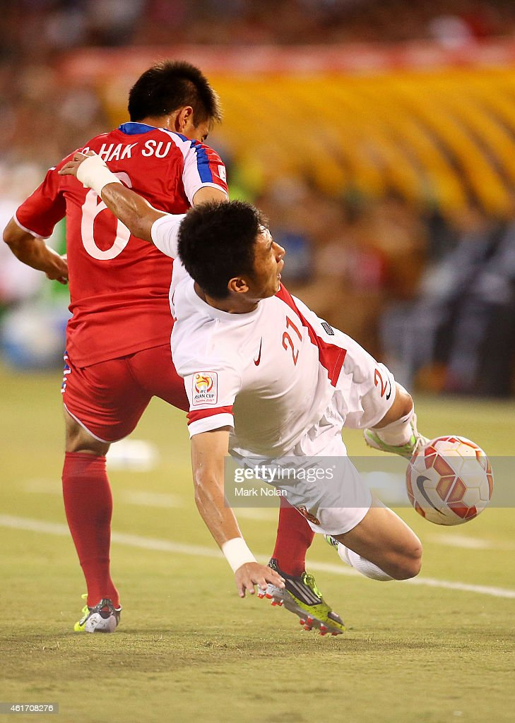 Ro Hak Su of DPR Korea tackles Yu Hai of China during the 2015 Asian Cup match between China PR and DPR Korea at Canberra Stadium on January 18, 2015 in Canberra, Australia.