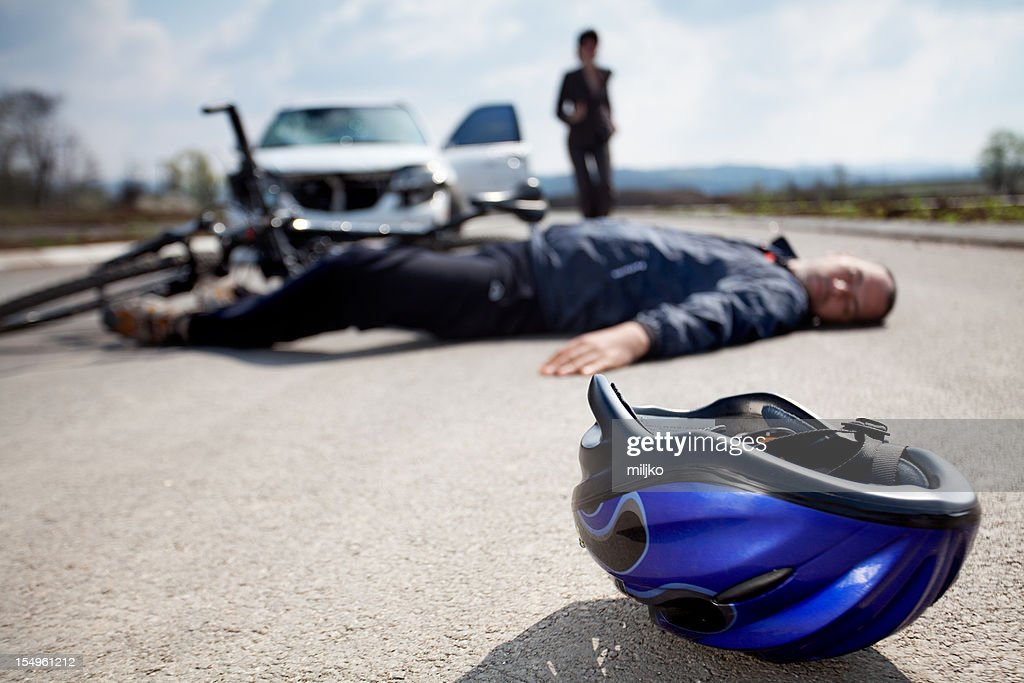 Road accident. Car and bicycle : Stock Photo
