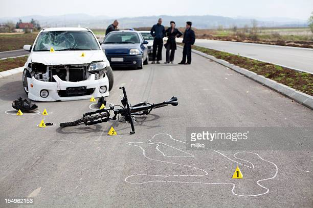A road accident with a bicycle and outline of a body