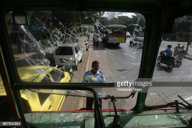 Road Accidents BEST inspector inspects the damage done to BEST bus by angry mob after the bus ran over Nagma Shaikh year old girl at Andheri on...