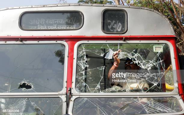 Road Accidents Police inspects the damage done to BEST bus by angry mob after the bus ran over Nagma Shaikh years old girl at Andheri on Wednesday