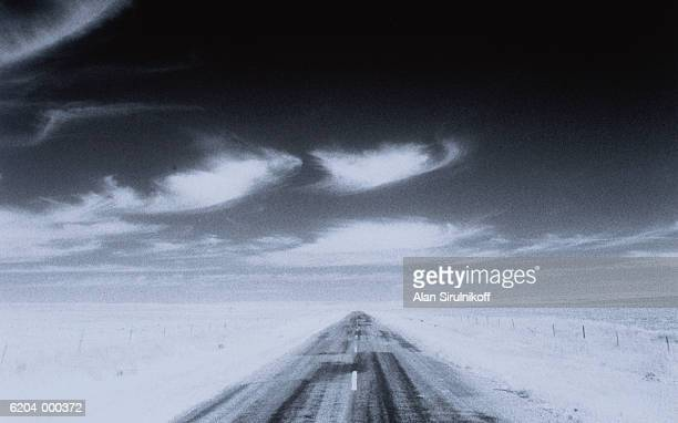 road across prairie - sirulnikoff stock photos and pictures