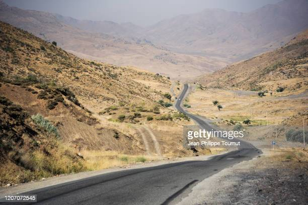 a road across rural kurdistan province, western iran - iran stock pictures, royalty-free photos & images