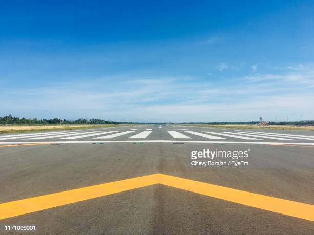 road against blue sky - runway stock pictures, royalty-free photos & images