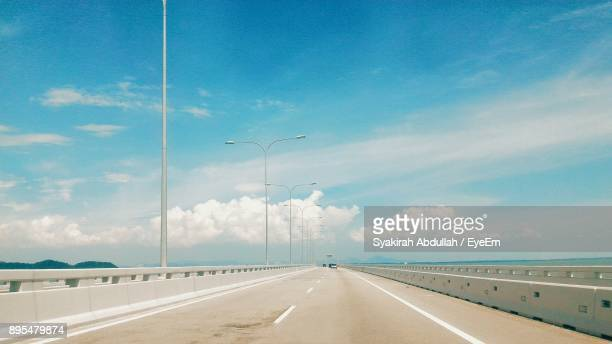 road against blue sky - thoroughfare stock photos and pictures