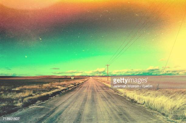 road against dramatic sky during sunset - castle rock colorado stock pictures, royalty-free photos & images
