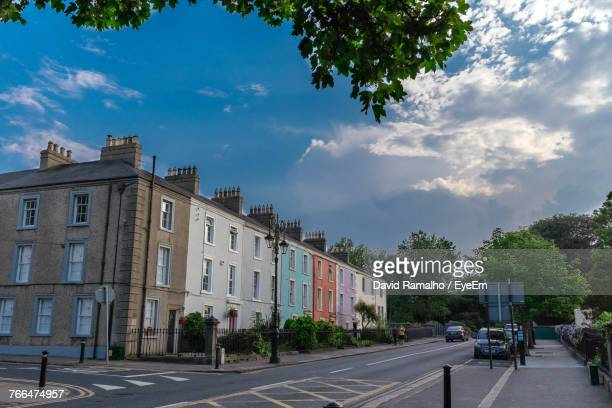 road against sky in city - malahide stock photos and pictures