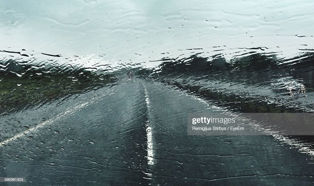 Road Against Sky Seen Through Wet Windshield During Monsoon : Stock Photo